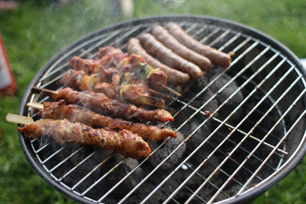 Sausages on a round barbecue